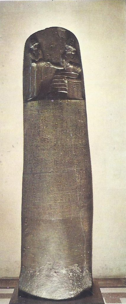 The black basalt Stele on which the Code of Hammurabi is inscribed. The lower part was erased by an Elamite king who captured the Stele about 1200 B. C.
