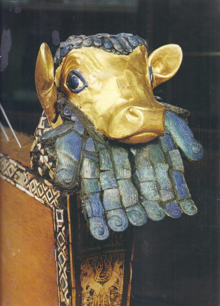 The golden head of a bull, decorating the front of a lyre from Ur.
