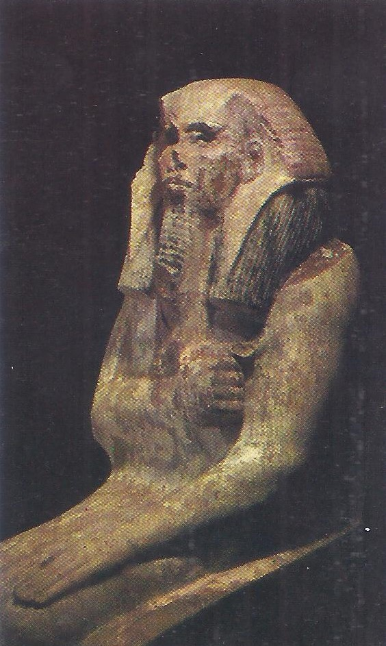 3000 BC. Seated statue of Pharaoh Djoser, from a chapel adjoining the step pyramid which was his tomb.