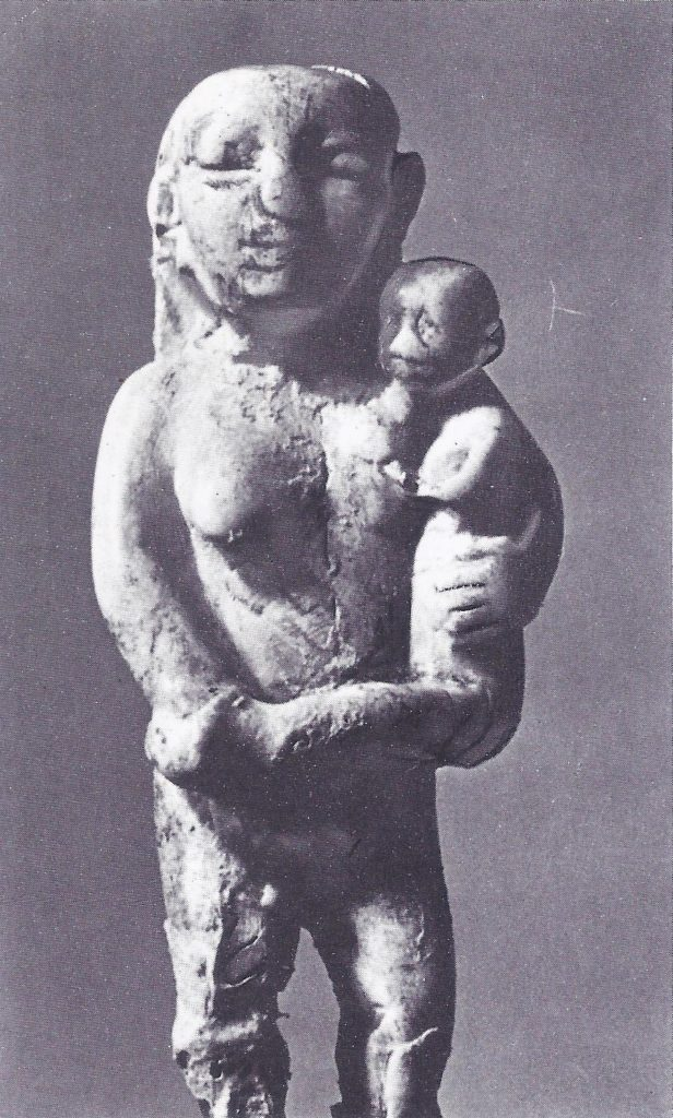 Pre-dynastic pottery group of mother and child.