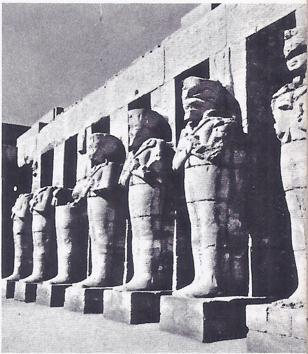 The Pharaoh Ramses III depicted on each of this row of colossal statues at Karnak.