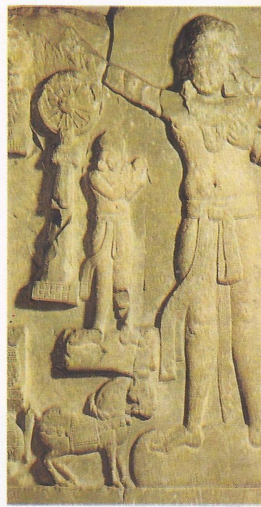 """Shakravartin -- """"he who turns the wheel"""" -- the ruler of the world, is shown in this marble relief of the school of Amaravati, dating from the first century B.C. or A.D."""