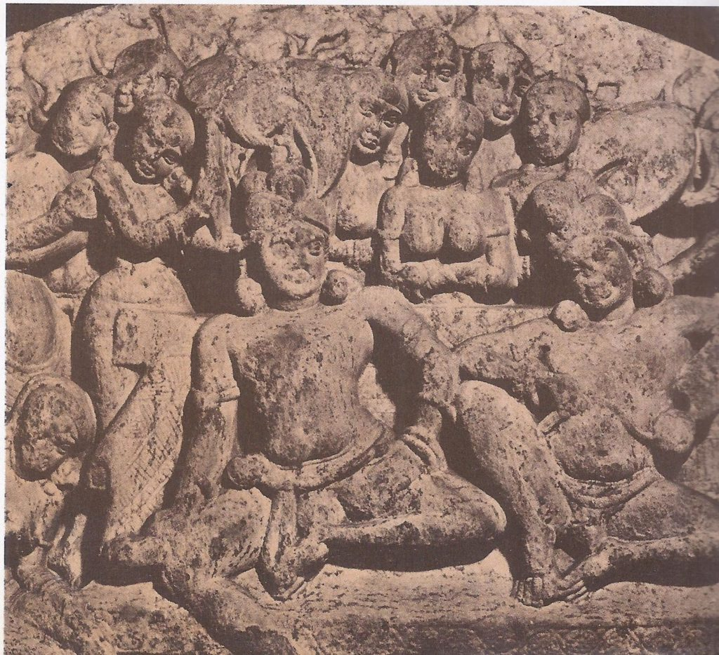 The Buddha with his father, surrounded by women of the harem. Shielded by his father in a life of luxury, the Buddha grew to early manhood before realizing the sorrow of life.