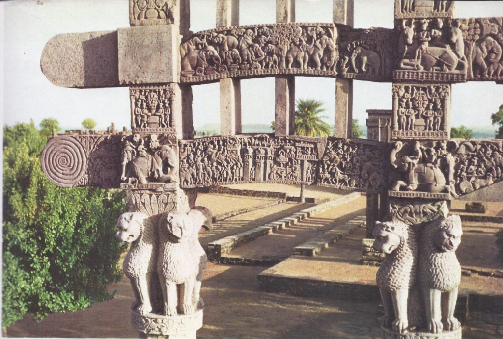 One of the gates of the stupa at Sanchi. A stupa is a Buddhist temple designed to house sacred relics or to commemorate the sacred character of a place or of an important event. In shape it is based on the funerary mound of the Vedas and symbolizes the cosmic mountain, the pivot of the world.